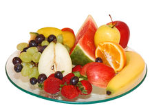 Selection of fruit on glass plate. With isolated background stock photos