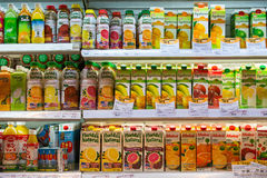 Selection fruit juices in a supermarket Siam Paragon in Bangkok, Thailand. Royalty Free Stock Images