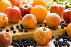 Selection of fruits on a wooden board. Stock Photography