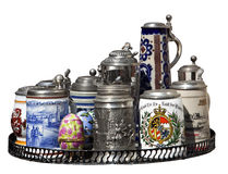 Selection of German steins. A selection of German drinking steins isolated Royalty Free Stock Photography
