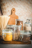 Selection of gluten-free products. Cereals: xanthan gum. buckwheat,Rice, rice noodles, chickpeas, lentils, corn, beans, oatmeal. In the home kitchen, in jars stock photo