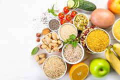 Selection of good carbohydrates sources. Healthy vegan diet. Selection of good carbohydrates sources - vegetables, fruits, grains, legumes, nuts and seeds royalty free stock photo