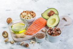 Selection of good fat sources - healthy eating concept. Ketogenic diet concept. Copy space stock photography