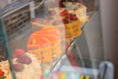 Selection of gourmet cakes in a bakery window Stock Photos