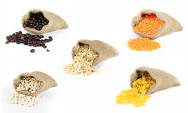 Selection of grain foods in bags. Selection of grains scattered from burlap bags on white background Stock Photography