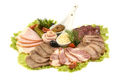 Selection of hams and salami. On a white background Stock Image