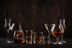 Selection of hard strong alcoholic drinks in big glasses and small shot glass in assortent: vodka, cognac, tequila, brandy and. Whiskey, grappa, liqueur royalty free stock image