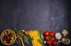 Selection of healthy food. Italian food background with spaghetti, mozzarella parmesan cheese, olives, tomatoes and rosemary. Vegetarian food banner. overhead Stock Images