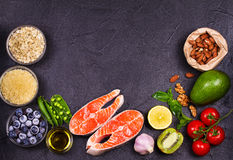 Selection of healthy and good for heart food. Healthy food concept with salmon, fresh vegetables, fruits and ingredients for cooki Royalty Free Stock Photos
