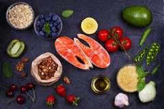 Selection of healthy and good for heart food. Healthy food concept with salmon, fresh vegetables, fruits and ingredients for cooki Stock Images