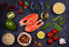 Selection of healthy and good for heart food. Healthy food concept with salmon, fresh vegetables, fruits and ingredients for cooki Stock Photo