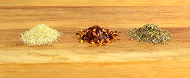 A selection of herbs and spices. Stock Photos
