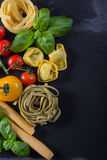 Selection of italian tipical food on black background Stock Images