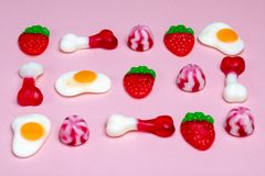 Selection of Jelly Sweets on a Pink Background royalty free stock photo