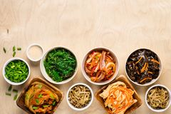 Selection of Korean Asian food in bowls on wooden background stock photo
