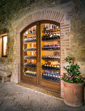 Selection of local tuscan wines. MONTEPULCIANO, ITALY - JUNE 26, 2015: Selection of local tuscan wines on a shop-window in antique Montepulciano town, Italy stock photos