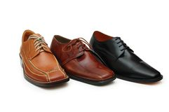 Selection of male shoes isolat. Ed on white - more footware in my portfolio Royalty Free Stock Photo