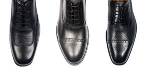 The selection of male shoes on white Royalty Free Stock Photos