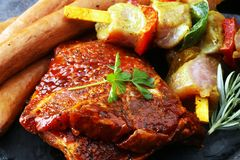 Selection of marinaded meat for bbq grilling with herbs on table Stock Photo