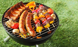 Selection of meat on a portable barbecue Royalty Free Stock Photography