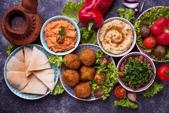 Selection of Middle eastern or Arabic dishes. Falafel, hummus, pita and  muhammara. Top view Royalty Free Stock Photography