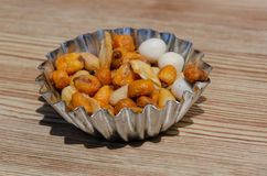 Selection of mixed nuts to eat as snack. Little bowl containing some mixed nuts. snack food stock photography