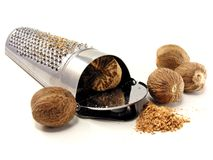 Selection of nutmeg with grater Royalty Free Stock Images