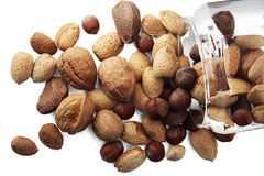 Selection of nuts. In a glass jar on white background stock photo