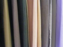 Selection Of Colorful Fabrics For Curtains, Rolls Of Fabrics. Woolen, Textiles. Stock Images