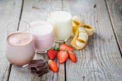 Free Selection Of Flavoured Milk - Strawberry, Chocolate, Banana Stock Photo - 84894400