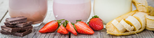 Free Selection Of Flavoured Milk - Strawberry, Chocolate, Banana Stock Photography - 84894732