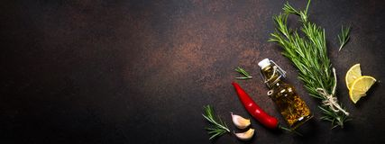 Free Selection Of Spices Herbs And Olive Oil On Dark Rusty Stone Table Stock Photography - 108836832