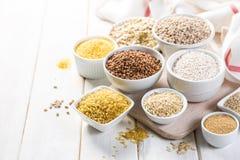 Free Selection Of Whole Grains In White Bowls - Rice, Oats, Buckwheat, Bulgur, Porridge, Barley, Quinoa, Amaranth, Royalty Free Stock Photo - 152675765