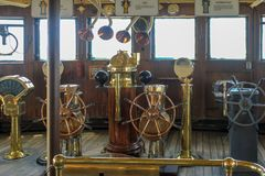 Selection of old copper and brass ships wheels royalty free stock photo