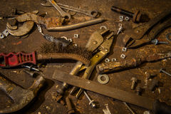 Selection of old worn well used tools on top of an old wooden wo. Rkbench stock photography