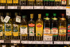 Selection of olive oil on the shelves in a supermarket Siam Paragon in Bangkok. Royalty Free Stock Photography
