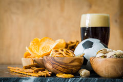 Selection of party food for watching football championship Stock Images
