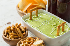 Selection of party food for watching football championship stock photos