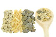 A selection of pine nuts, sunflower, pumpkin seeds Royalty Free Stock Image