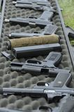 Selection of pistol firearms at the target practice range. Several handguns at the open air target range Colorado belonging to gun enthusiasts. June 2016 Royalty Free Stock Images