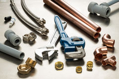 Selection of Plumbers Tools and Plumbing Materials. Various plumbers tools and plumbing materials including copper pipe, elbow joint, wrench and spanner. shot on stock image