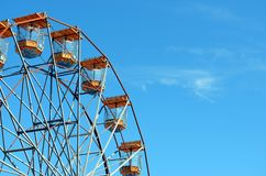 Arc of a ferris wheel against a blue sky. Selection of pods of a ferris wheel in a fairground Royalty Free Stock Images