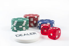 Poker chip. A selection of poker chips with dealer royalty free stock photography