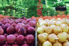 Selection of red onions and white onions on display on market stall, close-up Royalty Free Stock Photography