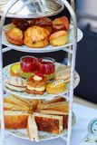 Selection of sandwiches and fancy cakes Royalty Free Stock Image