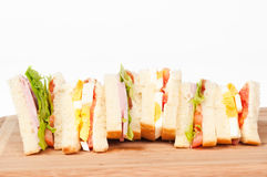 A selection of Sandwiches with various fillings. At a cutting board stock photos
