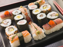 Selection of Seafood and Vegetable Sushi. On a Tray with chopsticks stock photos
