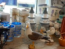 Selection of seaside in a shop. Selection of seaside or coast related gift items in a shop display porcelain cups and glassware seagulls candlesticks wood Royalty Free Stock Image