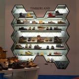 Selection shoes brand name - Timberland on a glass shelf at the Siam Paragon Mall, Bangkok. Stock Image