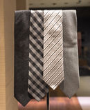 Selection of Silver Ties (2). Four Silver Ties with Different Patterns Stock Photography